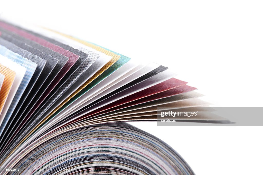 Rolled up magazine : Stock Photo