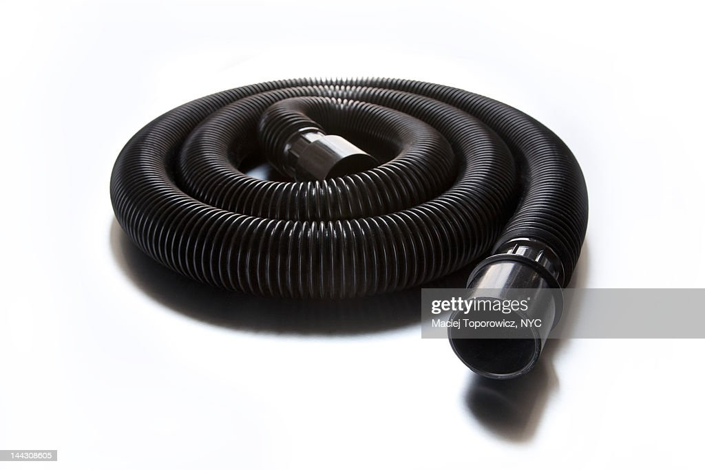 Rolled vacuum cleaner tube : Bildbanksbilder