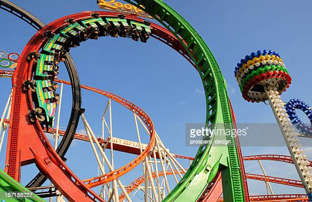 Roller coaster going around a multi-colored loop
