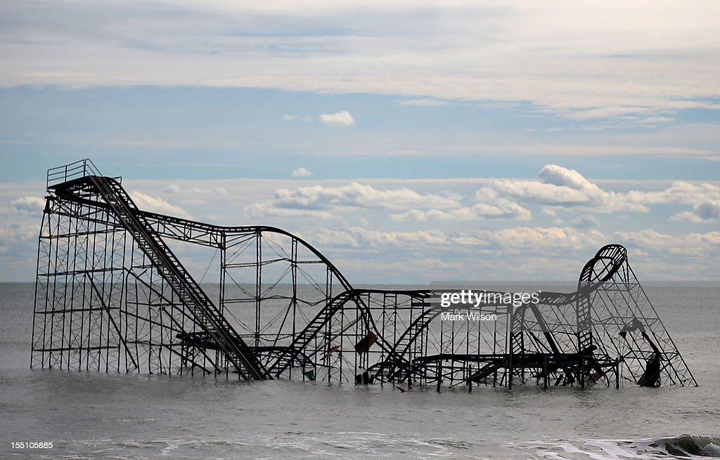 A roller coaster sits in the Atlantic Ocean after the Fun Town pier it sat on was destroyed by Superstorm Sandy on November 1, 2012 in Seaside Heights, New Jersey. With the death toll continuing to rise and millions of homes and businesses without power, the U.S. east coast is attempting to recover from the effects of floods, fires and power outages brought on by Superstorm Sandy.