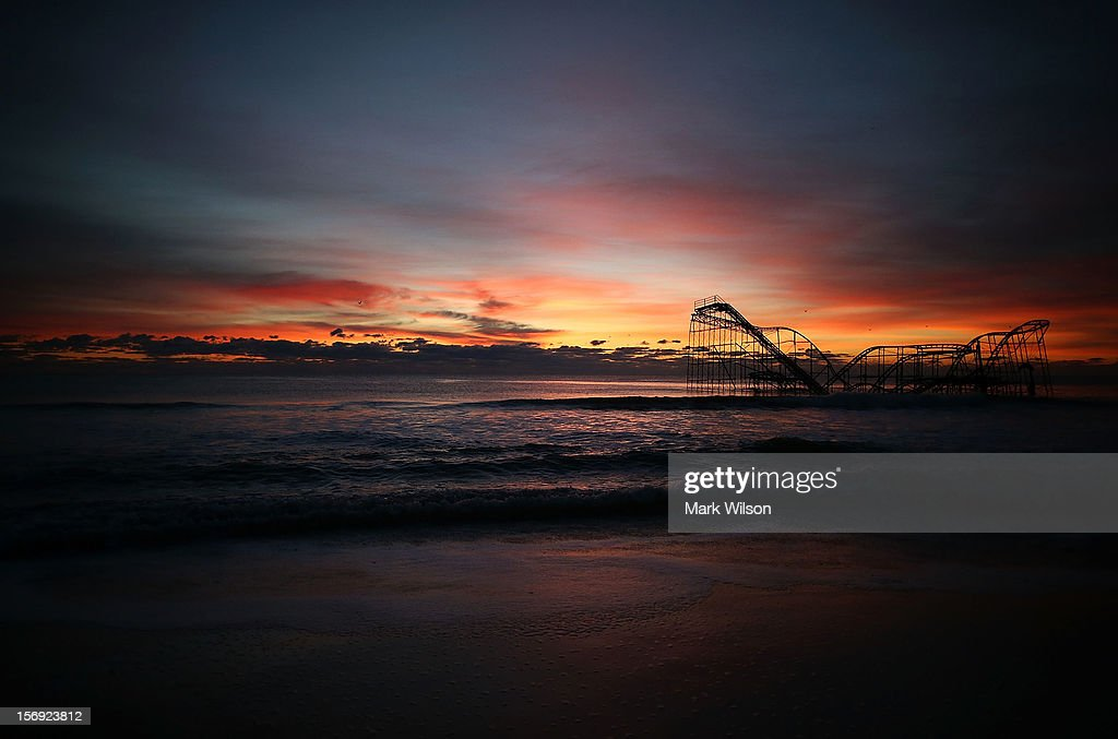 A roller coaster sits in the ocean after the Casino Pier collapsed when Superstorm Sandy hit, on November 25, 2012 in Seaside Heights, New Jersey. Mayor Bill Akers has asked the Coast Guard to find out whether the coaster is structurally stable, adding that it would make a great tourist attraction.