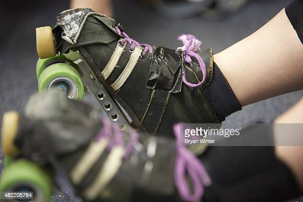 Closeup view of Queens of Pain taped up rollerskates in locker room before bout Brooklyn Bombshells at the Abe Stark Arena in Coney Island Equipment...