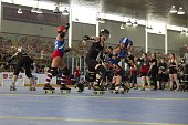 Queens of Pain Kitty Roadkill in action vs Brooklyn Bombshells ShadowboxHer at Abe Stark Arena in Coney Island Brooklyn NY 7/18/2015 CREDIT Bryan...