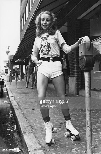A roller skater resting against a parking meter in Cambridge Massachusetts USA May 1979