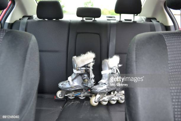 Roller skates on the back seat of a family car