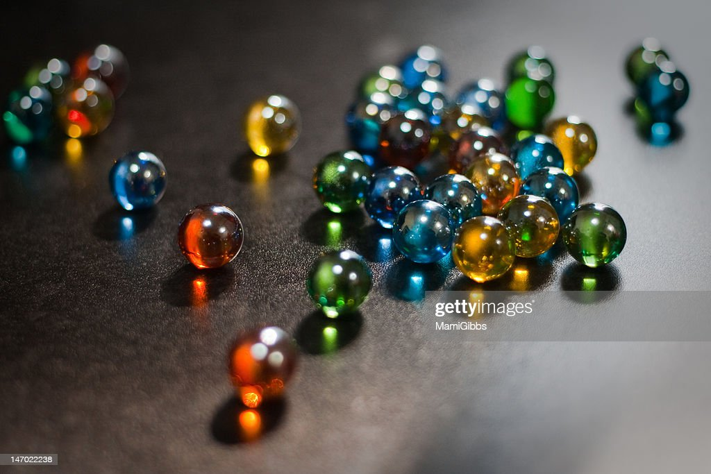 Rolling colorful marble. : Stock Photo
