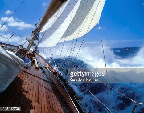 Rolling deck of yacht crashing through waves : Stock Photo