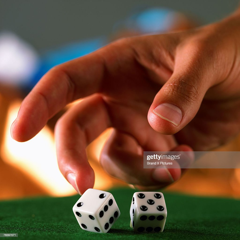Rolling dice : Stock Photo