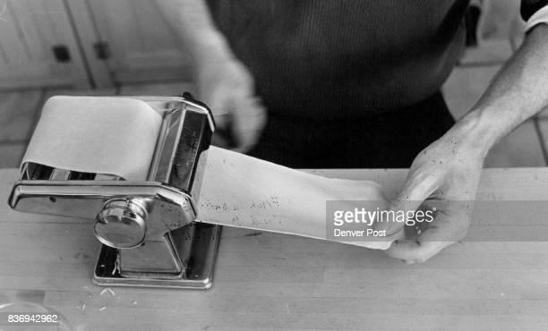 Rolling pasta through machine is first step in making ravioli Credit Denver Post