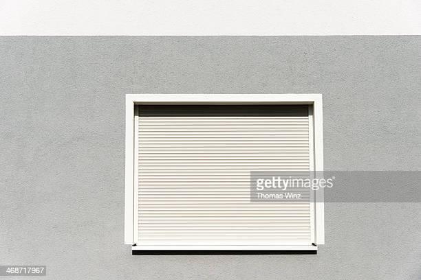 Rolling shutters over a window