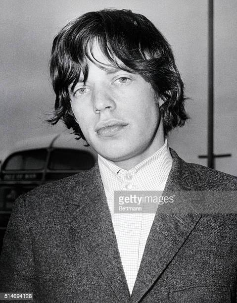 Rolling Stone lead singer Mick Jagger on arrival at the airport in London England