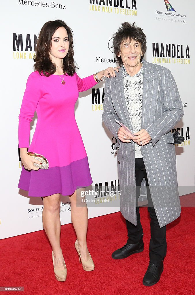 Rolling Stone Ronnie Wood and Sally Wood attend the screening of 'Mandela: Long Walk to Freedom' hosted by The Weinstein Company, Yucaipa Films & Videovision Entertainment, supported by Mercedes-Benz, South African Airways & DeLeon Tequila at Alice Tully Hall, Lincoln Center on November 14, 2013 in New York City.