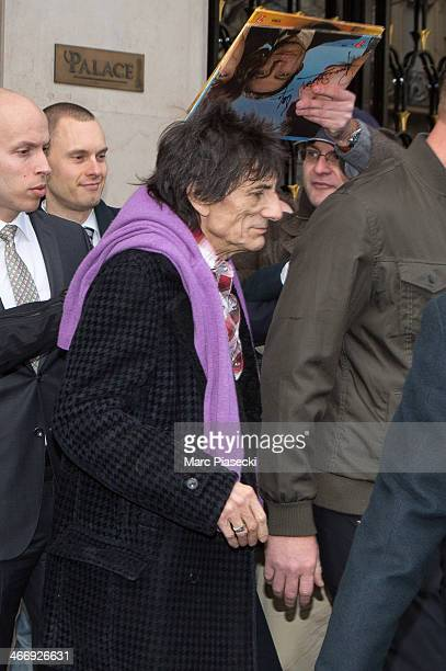 Rolling Stone Ronnie Wood is surrounded by french fans as he leaves the 'Four Seasons George V' hotel on February 5 2014 in Paris France