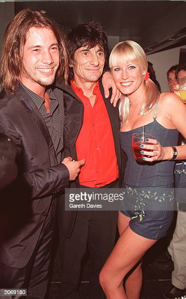 Rolling Stone Ronnie Wood with celebrity couple Denise Van Outen and Jay Kay at the opening of new club Home in Leicester Square London September 9...