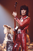Rolling Stones bassist Bill Wyman performing on stage 1976 On the left is singer Mick Jagger