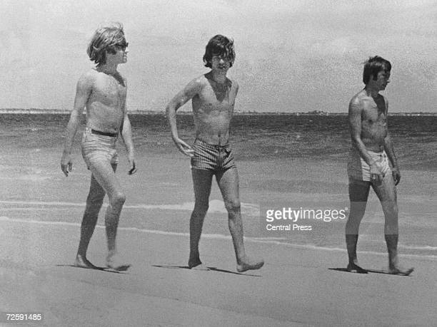 Rolling Stones Brian Jones Mick Jagger and Charlie Watts on the beach in Australia 1965