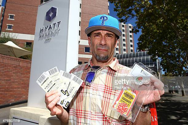 Rolling Stones fan Jeff Gussin from Philadelphia holds tickets purchased to Australian concerts outside the Hyatt Regency Perth where Mick Jagger and...