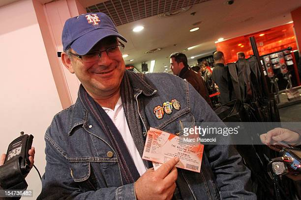 Rolling Stones fan shows his tickets for surprise concert at Virgin Megastore ChampsElysees on October 25 2012 in Paris France