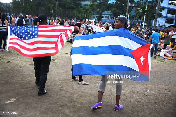 Rolling Stones fans wait for the start of a free concert March 26 2016 in Havana Cuba Thousands of fans waited for the Rolling Stones to play for the...