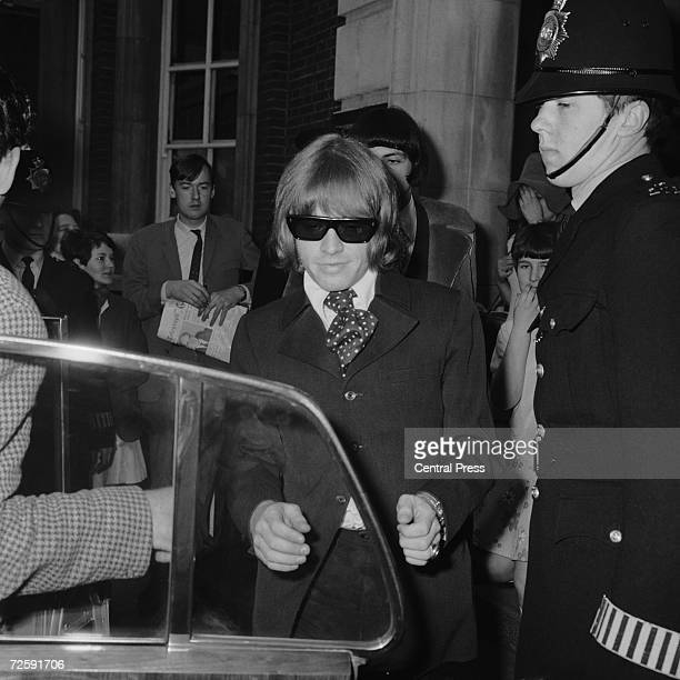 Rolling Stones guitarist Brian Jones leaves West London Magistrates Court in Kensington West London on the 11th of May 1967 after being charged with...