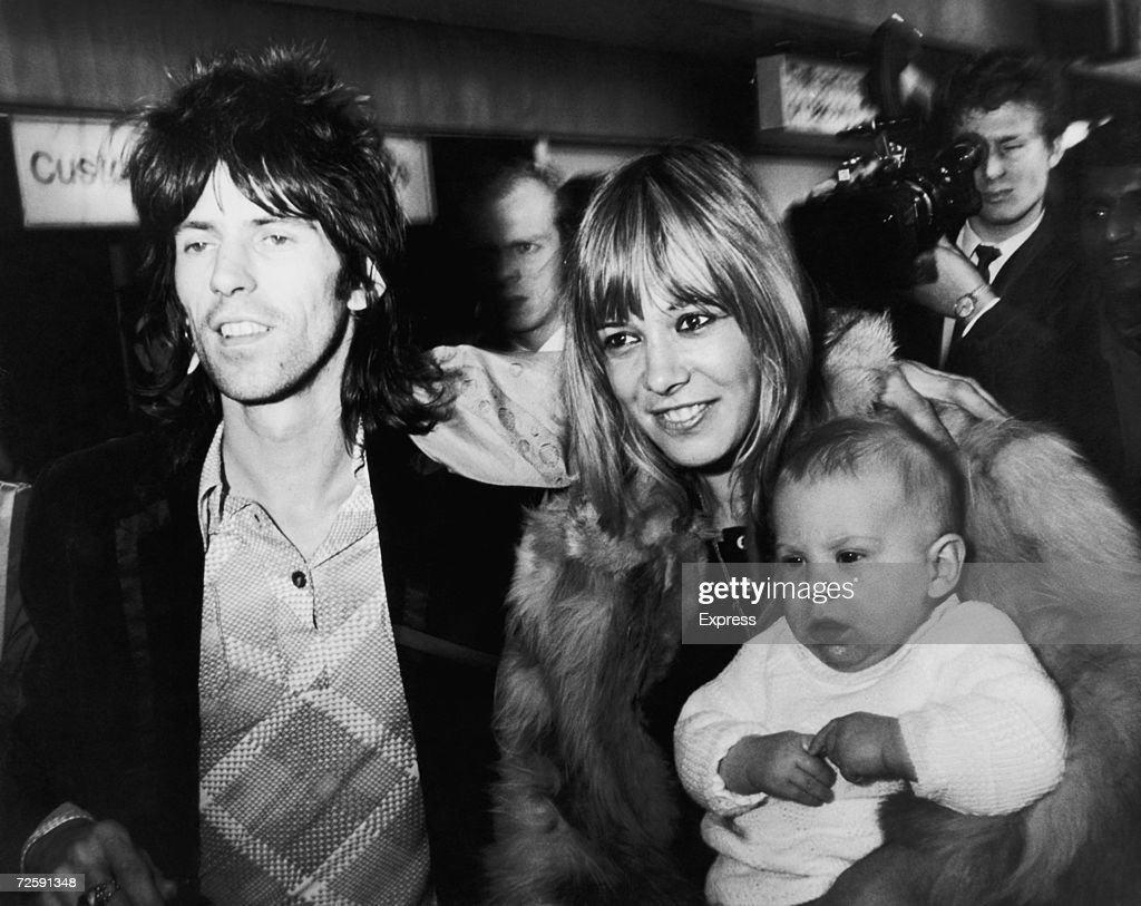 Rolling Stones guitarist <a gi-track='captionPersonalityLinkClicked' href=/galleries/search?phrase=Keith+Richards+-+Musician&family=editorial&specificpeople=202882 ng-click='$event.stopPropagation()'>Keith Richards</a> is reunited with girlfriend with Anita Pallenberg and their son, Marlon on his arrival at London Airport (now Heathrow) from the U.S., 8th December 1969 - shortly after the group's disastrous concert at Altamont.