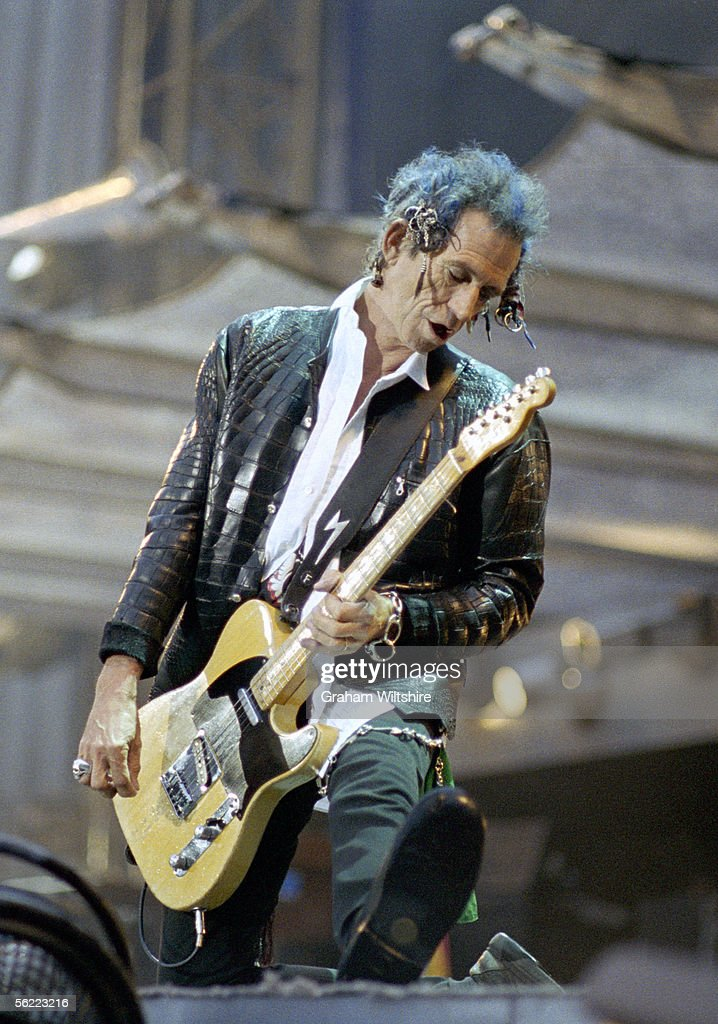 Rolling Stones guitarist <a gi-track='captionPersonalityLinkClicked' href=/galleries/search?phrase=Keith+Richards+-+Musician&family=editorial&specificpeople=202882 ng-click='$event.stopPropagation()'>Keith Richards</a> on stage at Wembley Stadium, London, July 1999, during the group's 'Bridges To Babylon' tour.