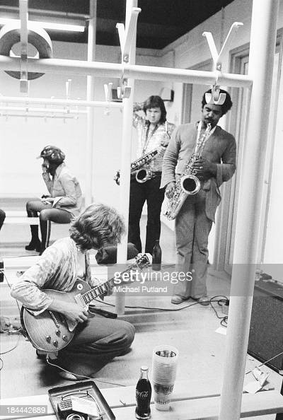Rolling Stones guitarist Mick Taylor backstage with saxophonists Bobby Keys and Trevor Lawrence at the Olympiahalle Munich Germany 28th September 1973