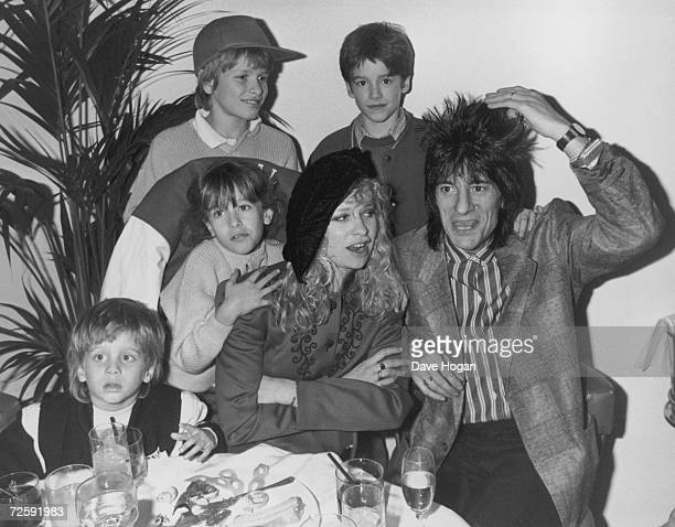 Rolling Stones guitarist Ron Wood with his wife Jo and their children Jamie Jesse Tyrone and Leah 19th February 1988 The family are dining out on the...