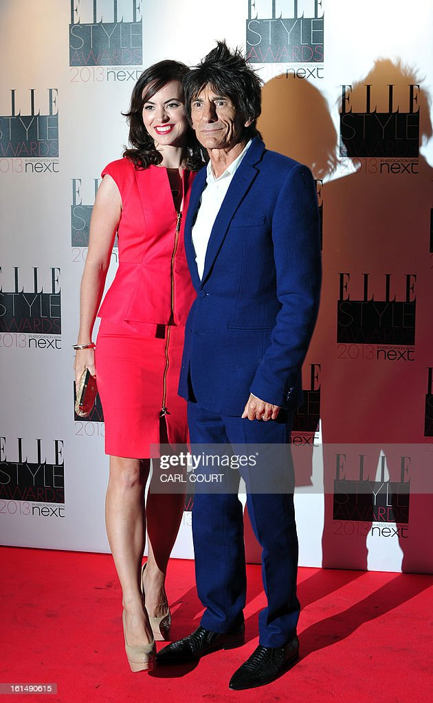 Rolling Stones guitarist Ronnie Wood and his wife Sally Humphries pose on the red carpet upon arrival to attend the Elle Style Awards in central London on February 11, 2013.