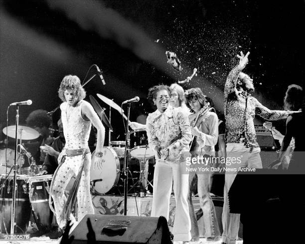 Rolling Stones Mick Jagger and Stevie Wonder are nearly creamed by cream pie