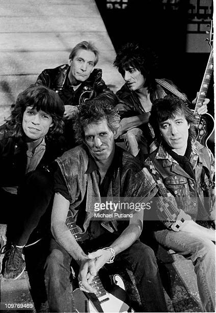 Rolling Stones on the set of the music video for 'One Hit ' in England in May 1986 Left to right are singer Mick Jagger drummer Charlie Watts...