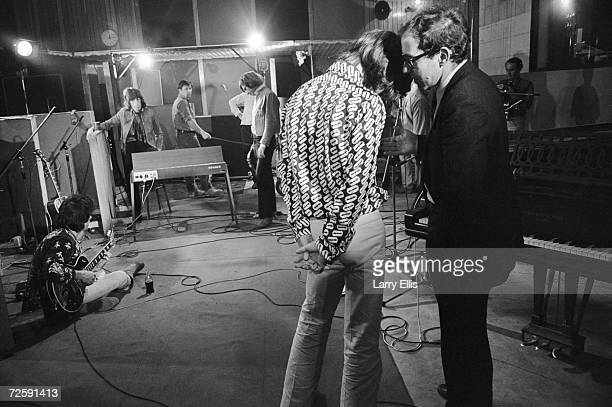 Rolling Stones singer Mick Jagger talking to French film director JeanLuc Godard at the Olympic Sound Studios while making Godard's semi documentary...