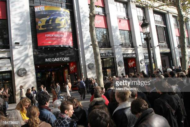 Rolling Stonesfans are seen waiting in line for surprise concert tickets at Virgin Megastore ChampsElysees on October 25 2012 in Paris France