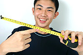 Young guy holding a rolling tape.