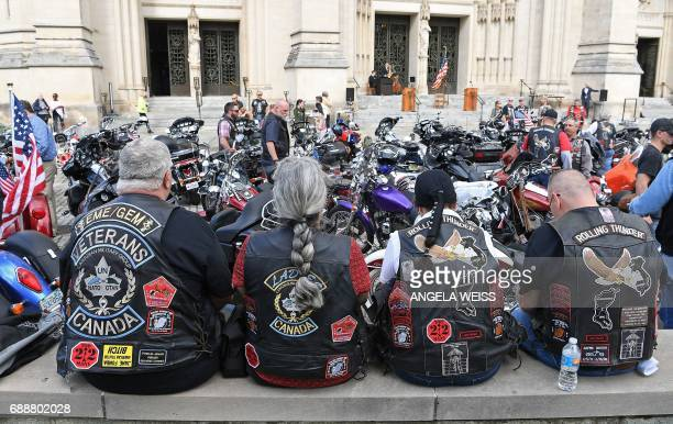 Rolling Thunder members and motocyclists wait for the 'Blessing of the Bikes' to start at at the Washington National Cathedral May 26 2017 in...