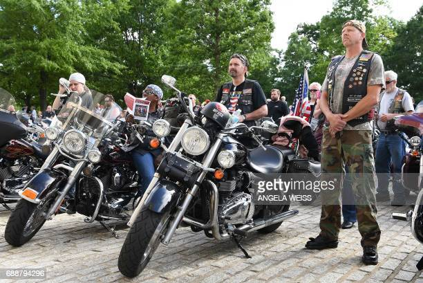 Rolling Thunder members and motorcyclists pray during the 'Blessing of the Bikes' at the Washington National Cathedral May 26 2017 in Washington DC /...