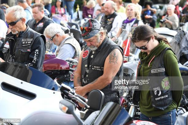 Rolling Thunder members pray during the 'Blessing of the Bikes' at the Washington National Cathedral May 26 2017 in Washington DC / AFP PHOTO /...