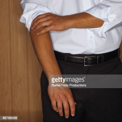 Rolling up sleeves : Stock Photo