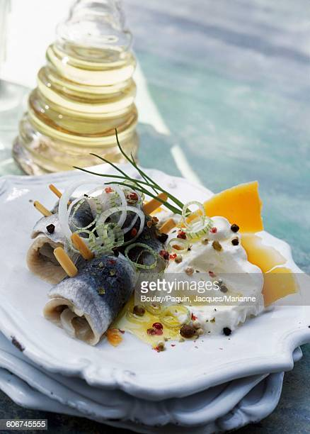 Rollmops with aged Mimolette,creme fraiche and five different peppercorns