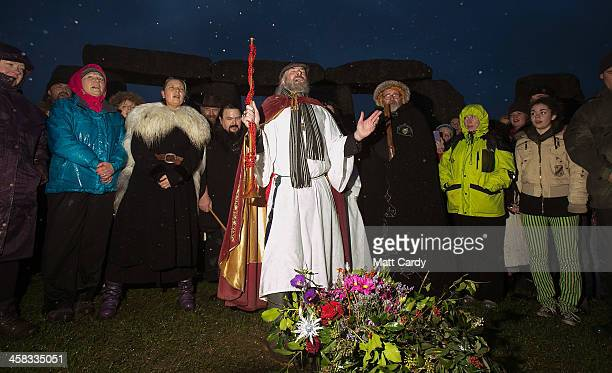 Rollo Maughfling Archdruid of Stonehenge Britain conducts a ceremony as druids pagans and revellers gather hoping to see the sun rise as they take...
