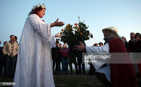 Rollo Maughfling the Archdruid of Glastonbury and Stonehenge conducts a Beltane dawn celebration service in front of St Michael's Tower on...