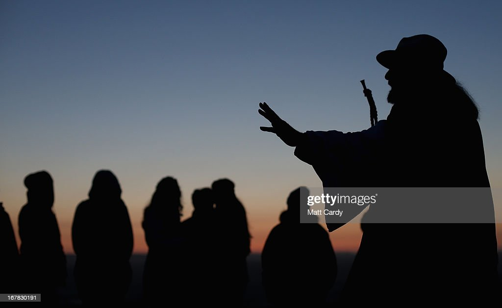 Rollo Maughfling, (R) the Archdruid of Glastonbury and Stonehenge conducts a Beltane dawn celebration service in front of St. Michael's Tower on Glastonbury Tor on May 1, 2013 in Glastonbury, England. Although more synonymous with International Workers' Day, or Labour Day, May Day or Beltane is celebrated by druids and pagans as the beginning of summer and the chance to celebrate the coming of the season of warmth and light. Other traditional English May Day rites and celebrations include Morris dancing and the crowning of a May Queen with celebrations involving a Maypole.