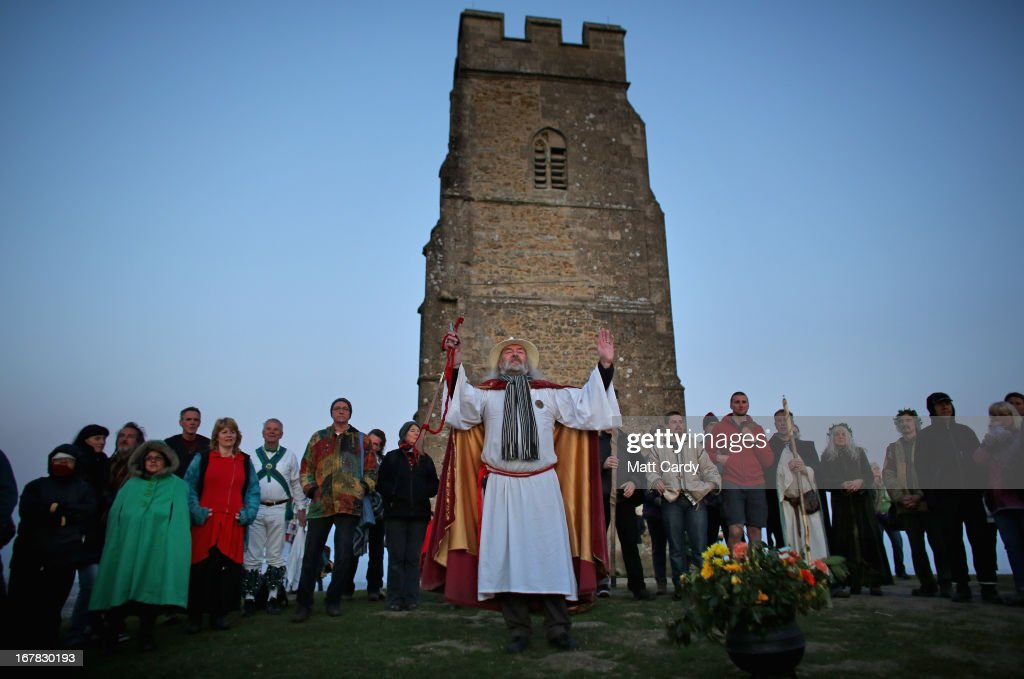 Rollo Maughfling, (C) the Archdruid of Glastonbury and Stonehenge conducts a Beltane dawn celebration service in front of St. Michael's Tower on Glastonbury Tor on May 1, 2013 in Glastonbury, England. Although more synonymous with International Workers' Day, or Labour Day, May Day or Beltane is celebrated by druids and pagans as the beginning of summer and the chance to celebrate the coming of the season of warmth and light. Other traditional English May Day rites and celebrations include Morris dancing and the crowning of a May Queen with celebrations involving a Maypole.