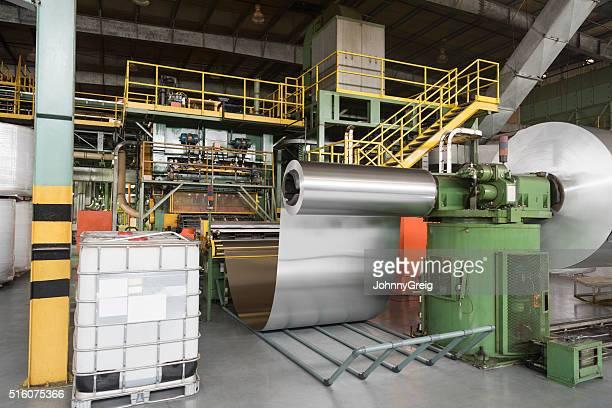 Rolls of aluminium metal in processing plant