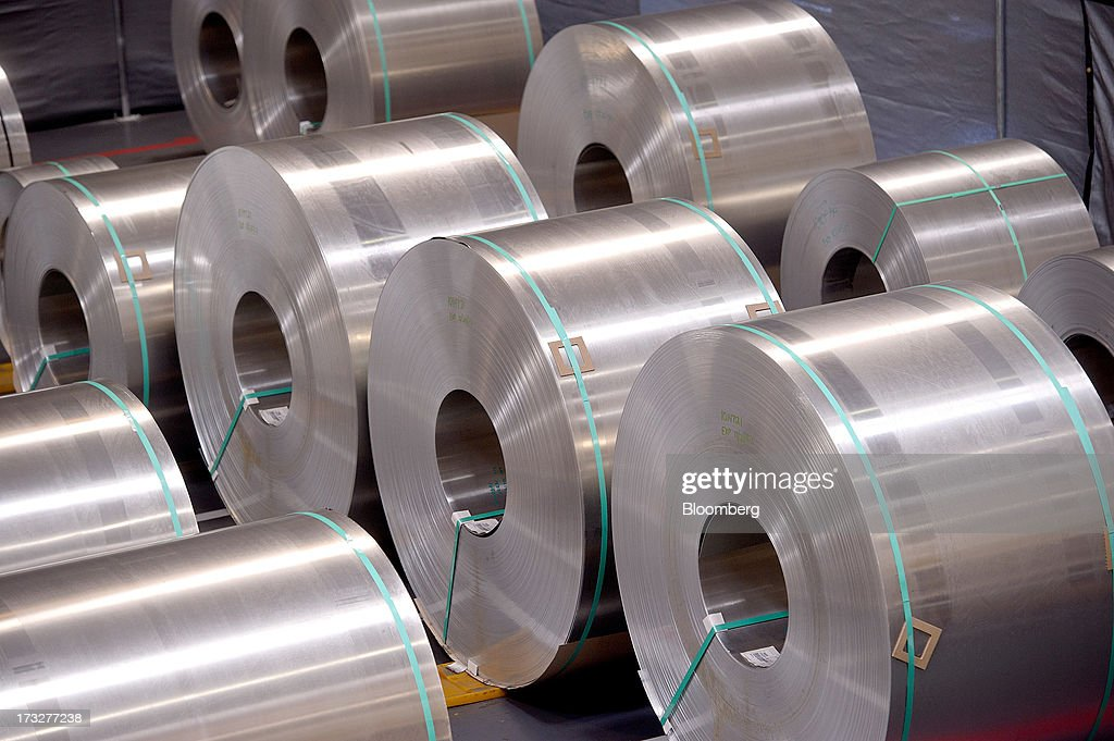 Rolls of aluminum for making Telsa Motor Inc. Model S sedans wait to be stamped at the company's assembly plant in Fremont, California, U.S., on Wednesday, July 10, 2013. Tesla, is building Model S electric sedans faster than its initial 400-a-week goal as demand and the companys production skills increase, Chief Executive Officer Elon Musk said. Photographer: Noah Berger/Bloomberg via Getty Images