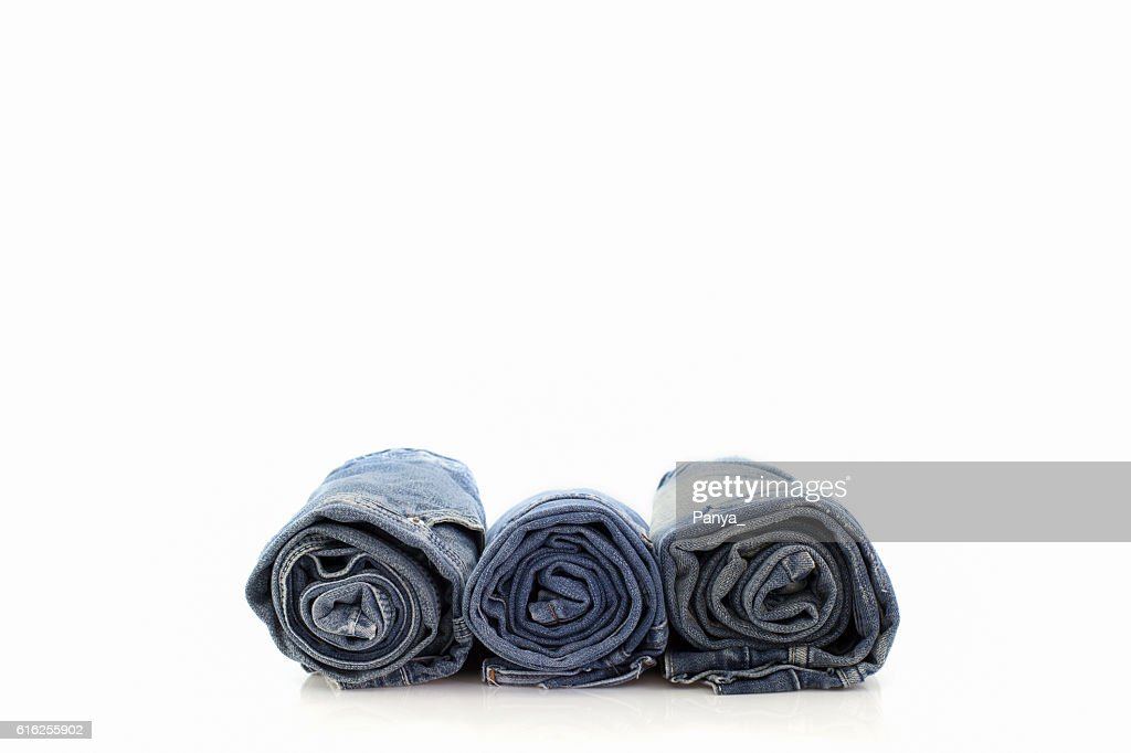 Rolls of blue Jeans isolated on white background. : Stock Photo