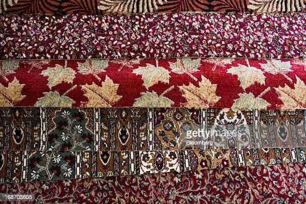 Rolls of carpets sit on display for sale at a store in Srinagar India on Monday May 13 2013 Indian inflation eased to a 41month low in April giving...