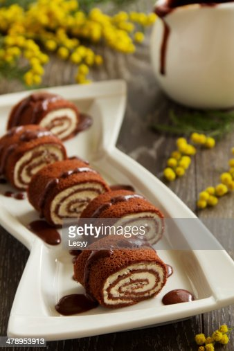 Rolls of chocolate pancakes with cottage cheese. : Stock Photo