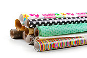 rolls of colorful wrapping paper isolated on white background