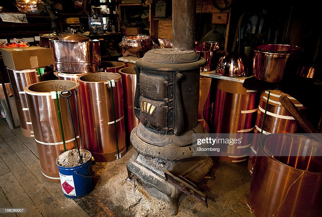 Rolls of copper sit around an old pot belly wood stove at the D Picking & Co. facility in Bucyrus, Ohio, U.S., on Tuesday, Dec. 11, 2012. Copper rose on bets that moves by the Federal Reserve to expand economic stimulus will weaken the dollar and boost demand in the U.S., the world's second-largest user of the metal. Photographer: Ty Wright/Bloomberg via Getty Images
